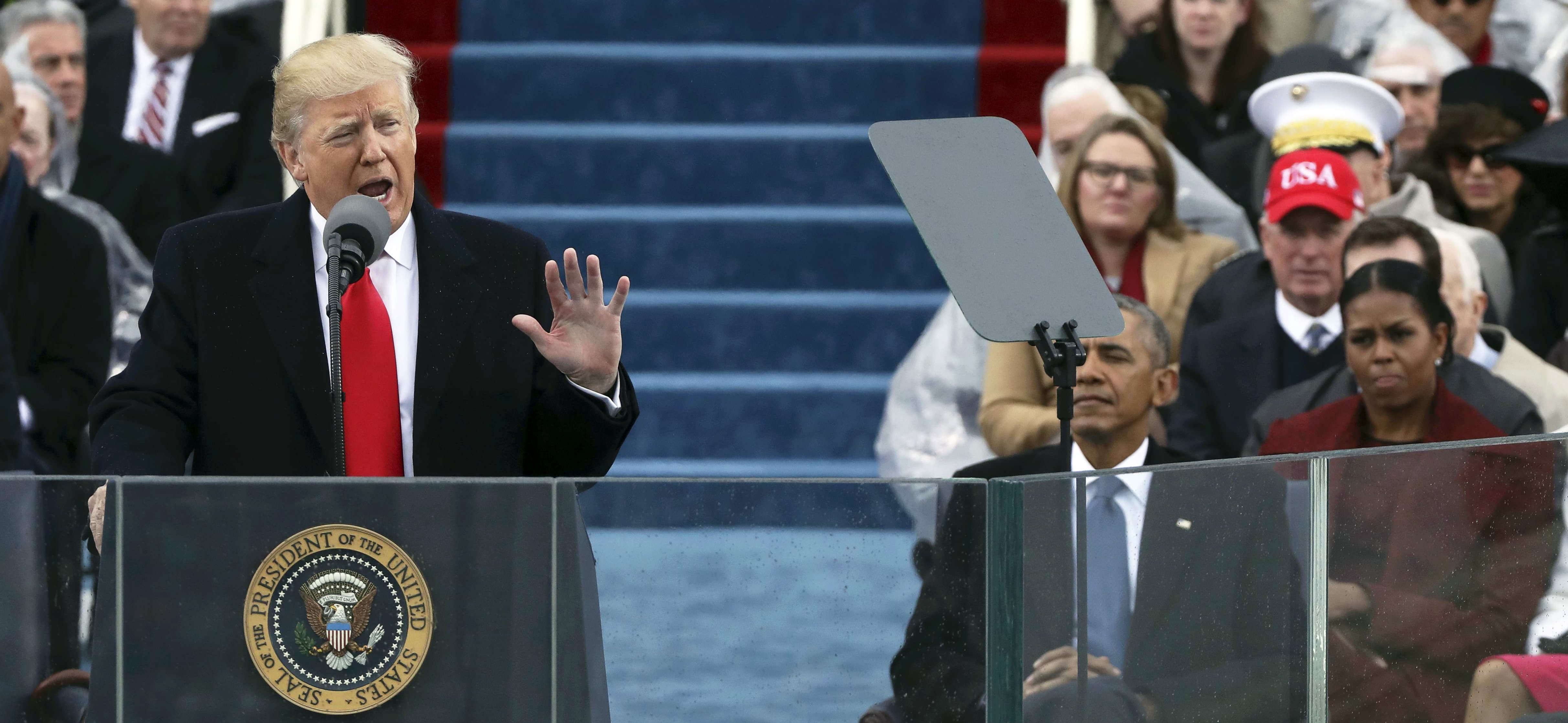 President Donald Trump (L) speaks at inauguration ceremonies swearing him in as the 45th president of the United States on the West front of the U.S. Capitol in Washington, U.S., January 20, 2017. REUTERS/Carlos Barria