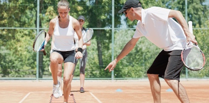 Intensive cardio tennis training - instructor working with girls